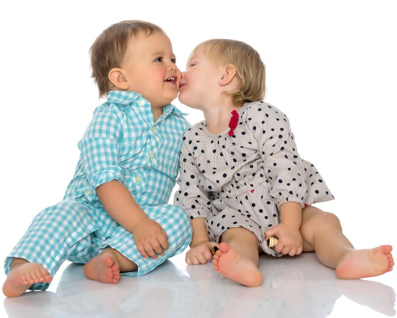 Babies boys and a girl cute embrace. royalty free stock image