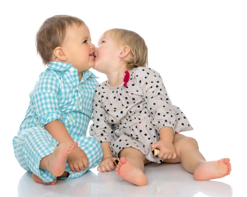 Babies boys and a girl cute embrace. stock image