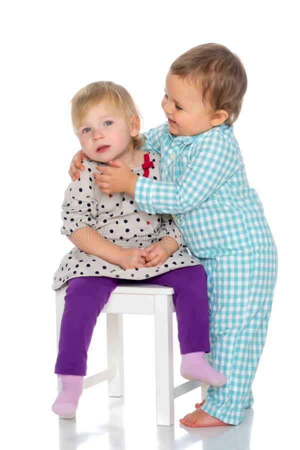 Babies boys and a girl cute embrace. royalty free stock photos