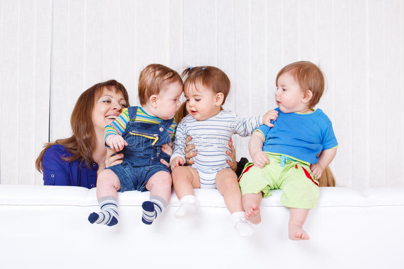 Babies communicating. While sitting on sofa royalty free stock photo