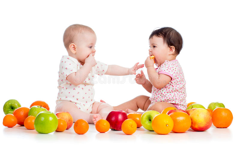 Babies Eating Fruits Stock Photography