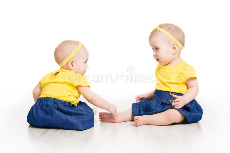 Babies Girls Twins, Two Kids Sitting on Floor, Children Sisters stock photo