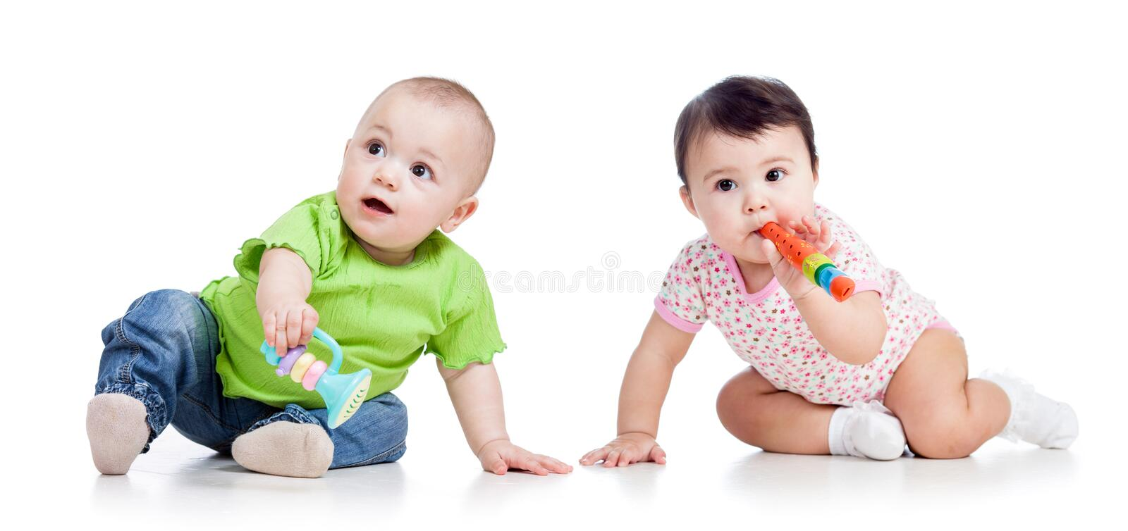 Babies kids play. Funny babies girls with musical toys on white royalty free stock photos