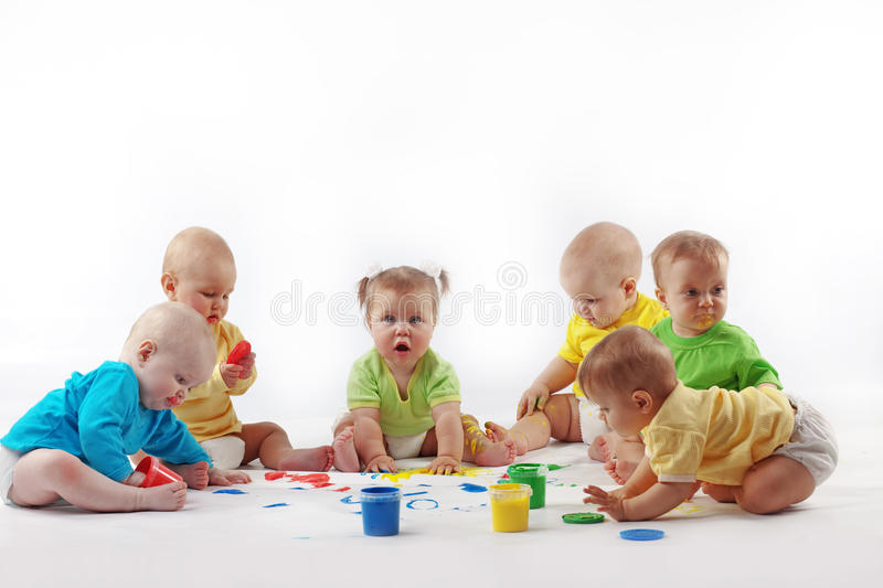 Babies painting stock images