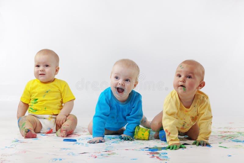 Babies painting royalty free stock photos