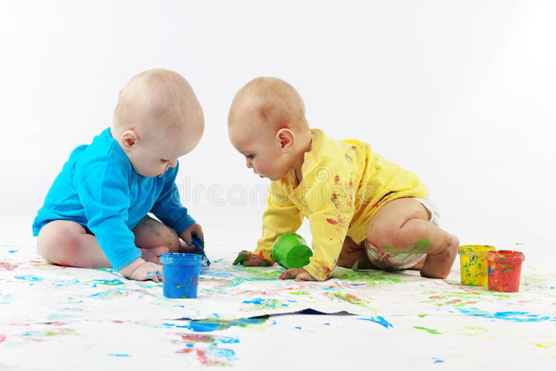 Babies painting royalty free stock image