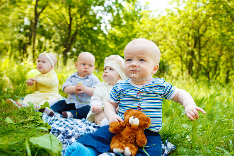 Babies in park royalty free stock image