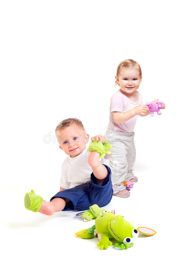 Babies play with toys royalty free stock photo