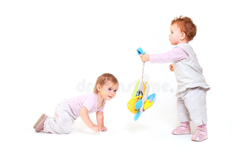 Babies play with toys royalty free stock photos