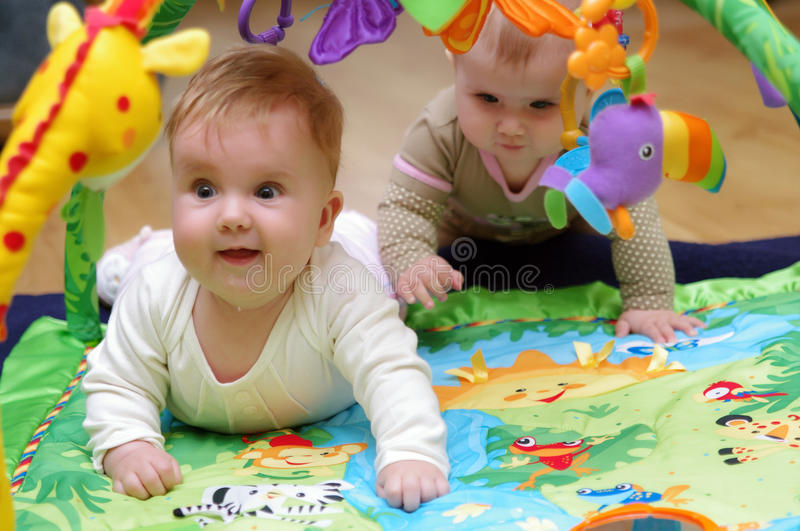 Babies playing royalty free stock image