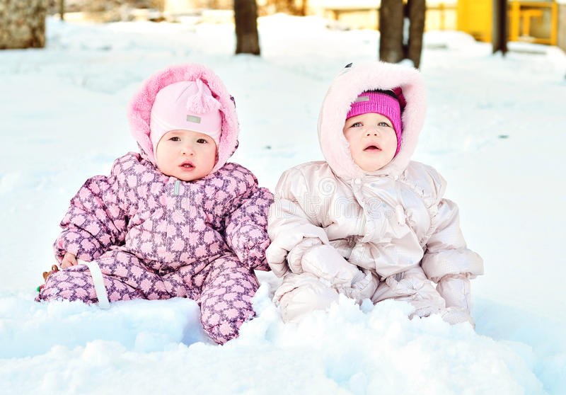 Babies in snow royalty free stock photo