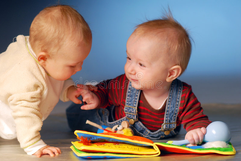 Babies with toys royalty free stock photos