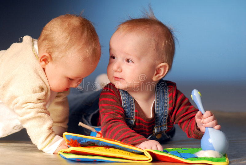 Babies with toys stock photos