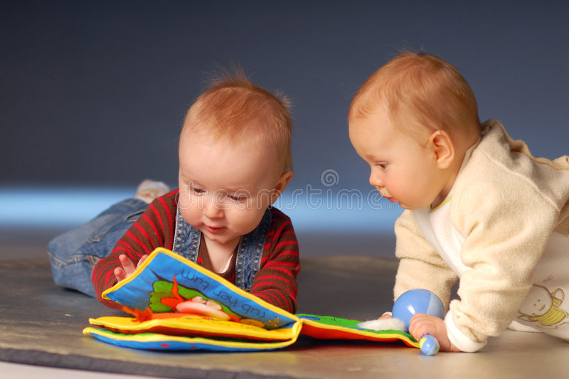 Babies with toys stock photography