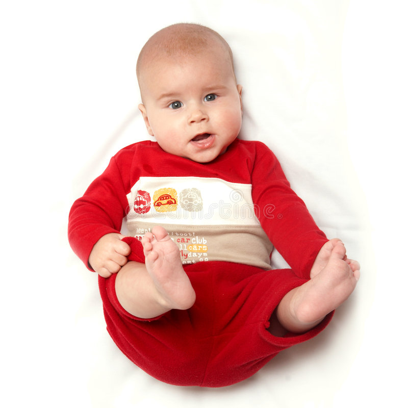 Baby 2. Baby in red playing with legs stock images