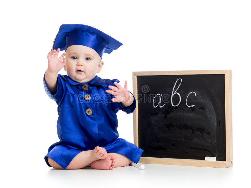 Baby in academician clothes and chalkboard royalty free stock image