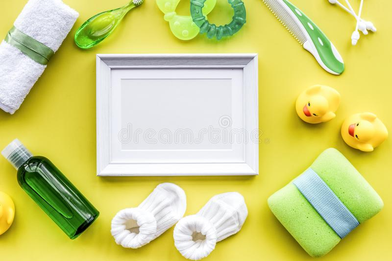 Baby accessories for bath with body cosmetic, frame and ducks on royalty free stock photography