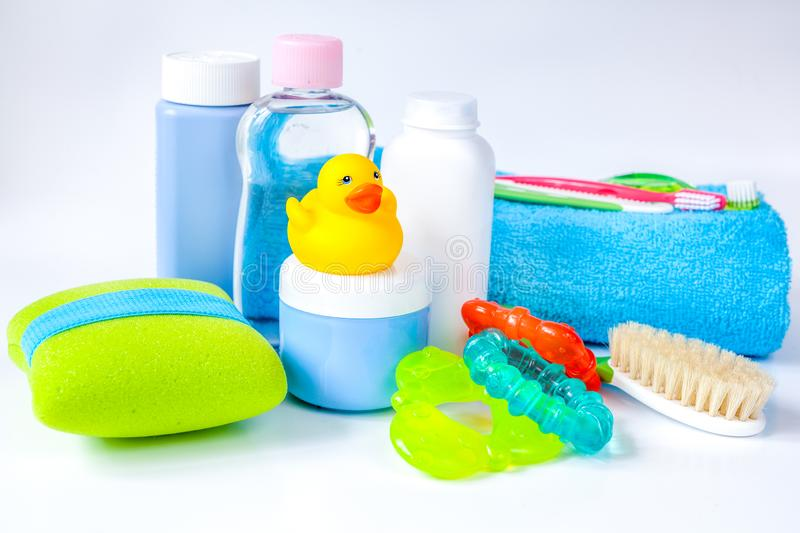 Baby accessories for bath with duck on white background stock photos