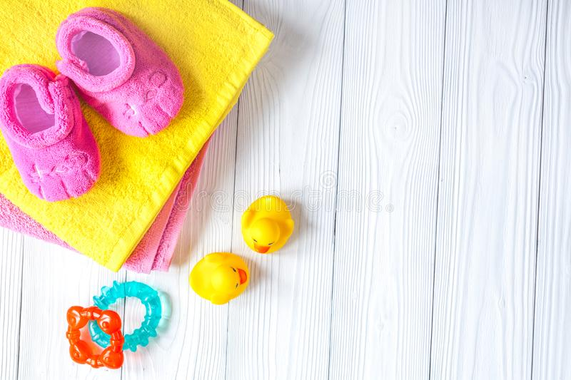 Baby accessories for bath on wooden background stock photos