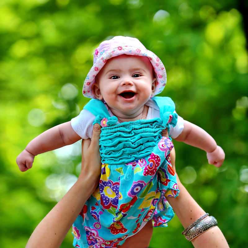 Baby in the air royalty free stock image