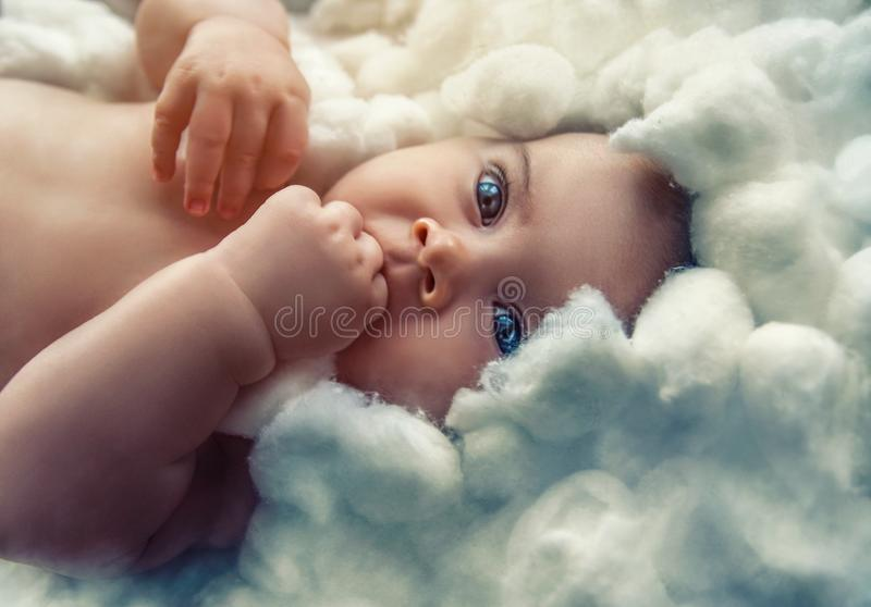 Baby angel watchin in your eyes royalty free stock image