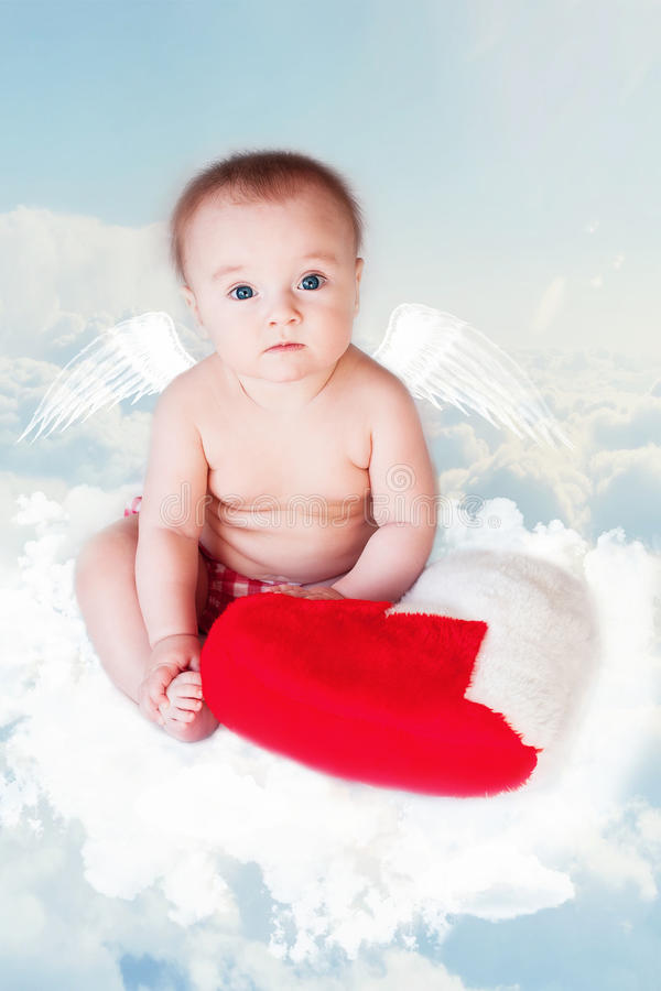 Baby Angel with Wings, Newborn Kid at Blue Sky Cloud royalty free stock photos