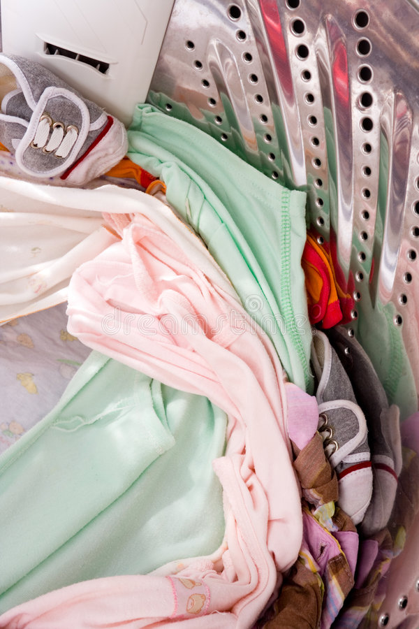 Baby apparel in washing machine stock image