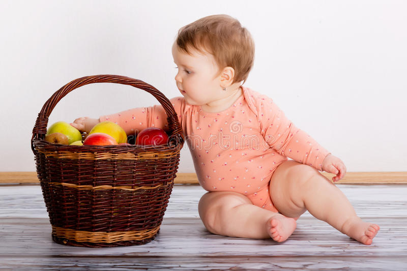 Baby with apples royalty free stock photography