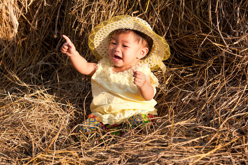 Download Baby of Asia sits in straw stock image. Image of baby - 13286947