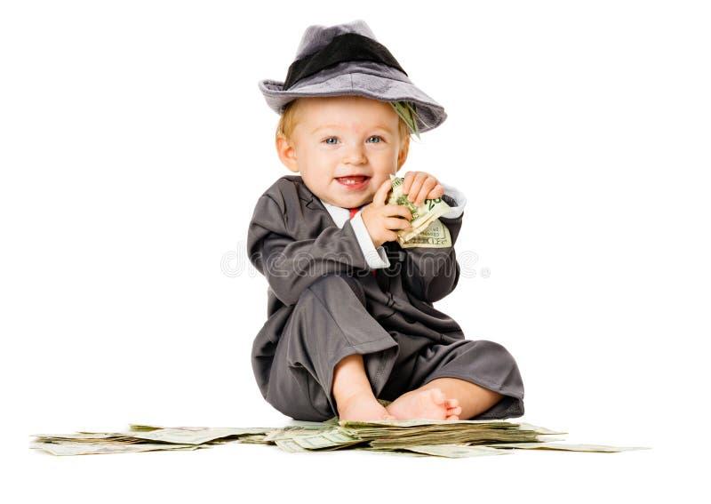 Baby auf Stapel des Geldes lizenzfreie stockfotos