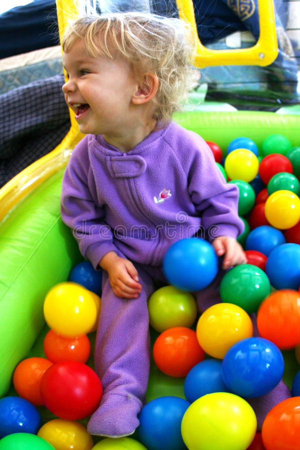 Baby in a Ball Pit. A baby playing in a ball pit royalty free stock image