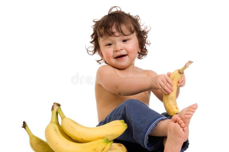 Baby with banana. stock photo