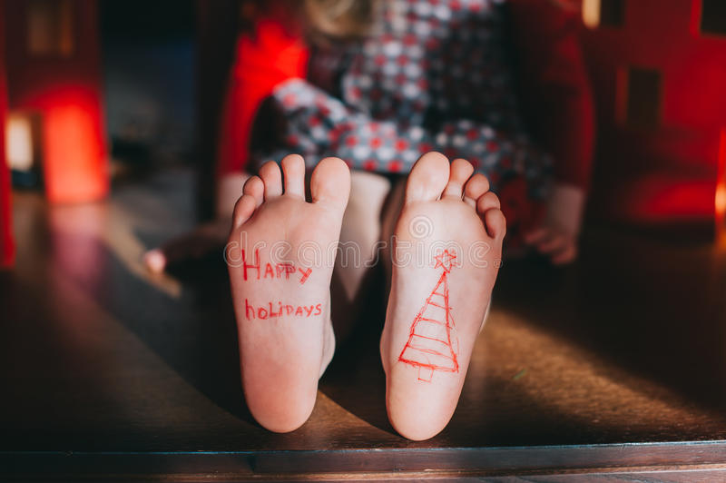 Baby bare feet on the wooden floor. Christmas celebration concept royalty free stock image