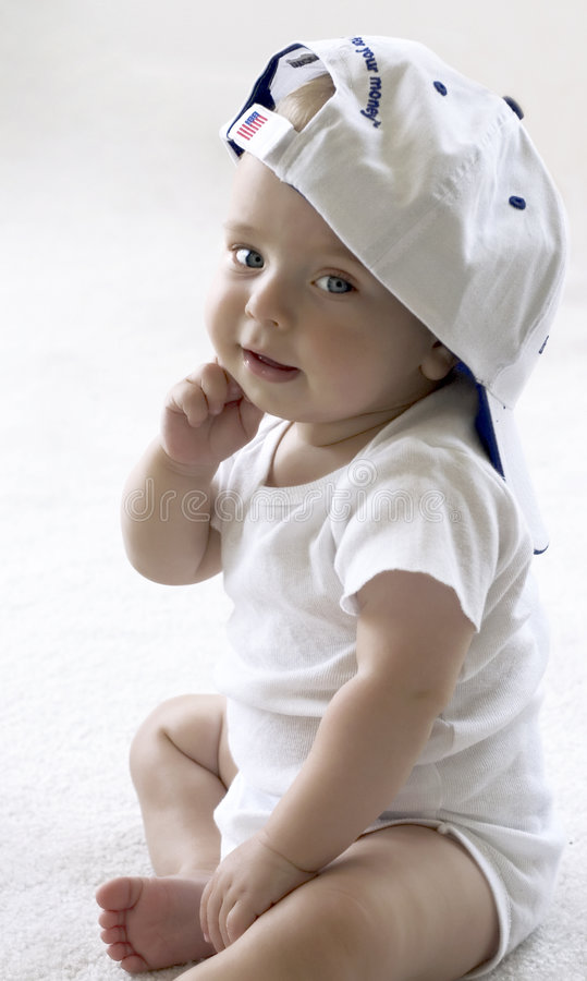Baby in a baseball cap stock image
