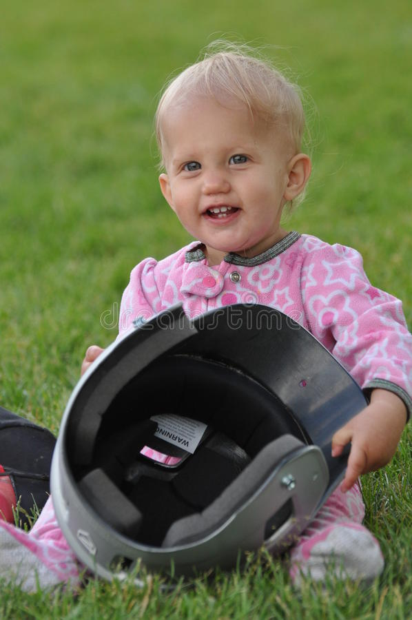 Baby with baseball helmet stock photography