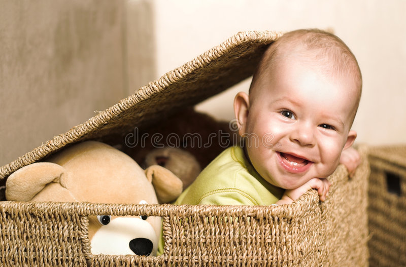 Baby in the basket stock images