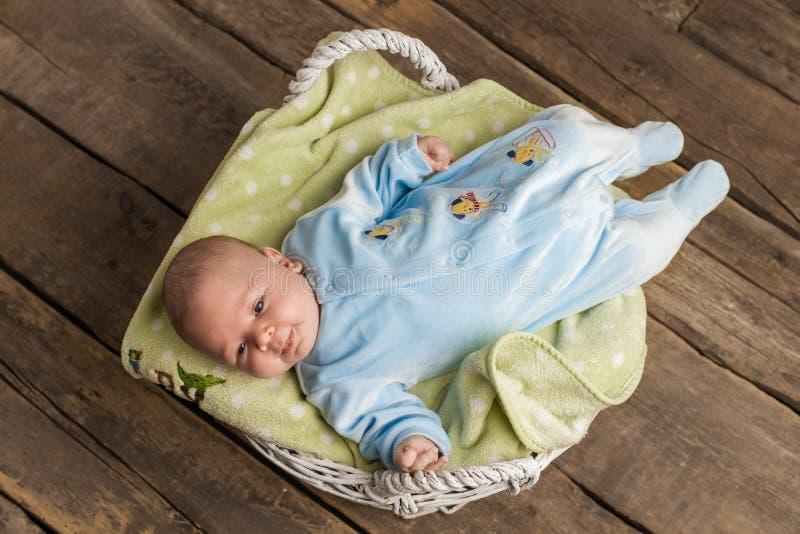 Baby in basket smiling. stock image