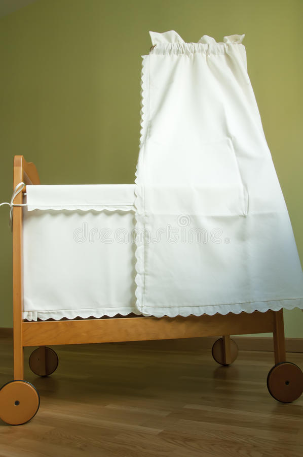 Baby bassinet. In the bedroom stock photography