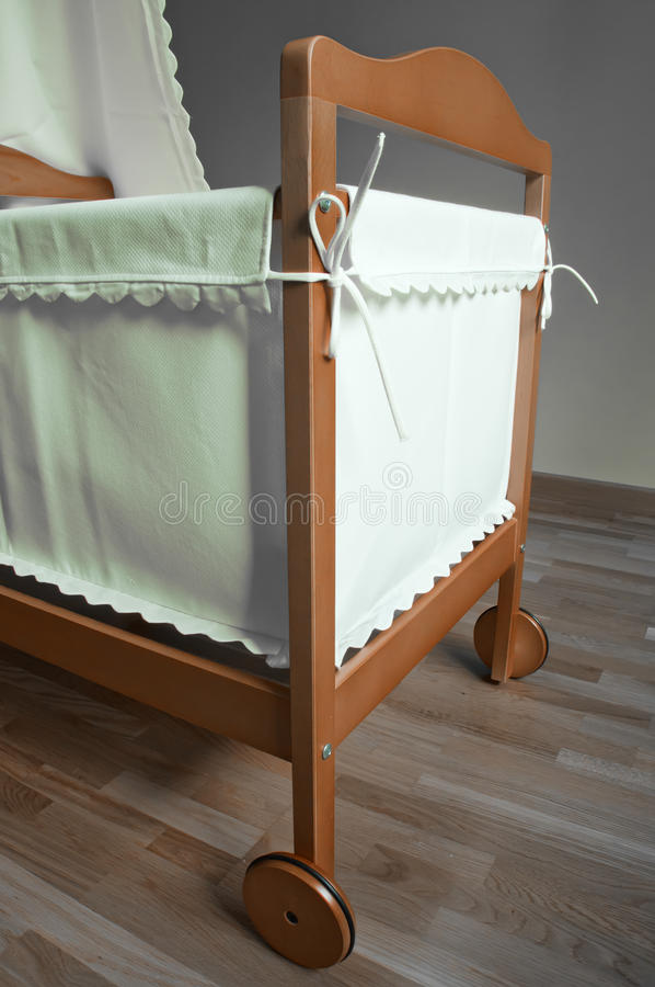 Baby bassinet. In the bedroom royalty free stock photo