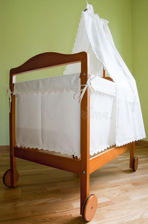 Baby bassinet. In the bedroom stock images