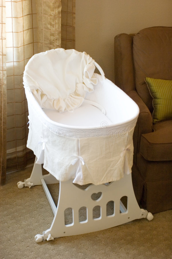 Baby bassinet. In the bedroom royalty free stock image