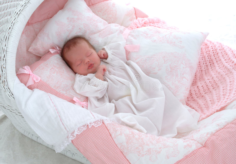 Baby in Bassinet stock image