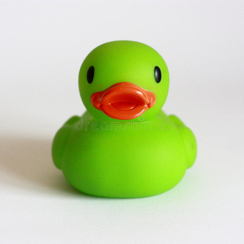 Baby bath duck - green. Duckie on white background stock image