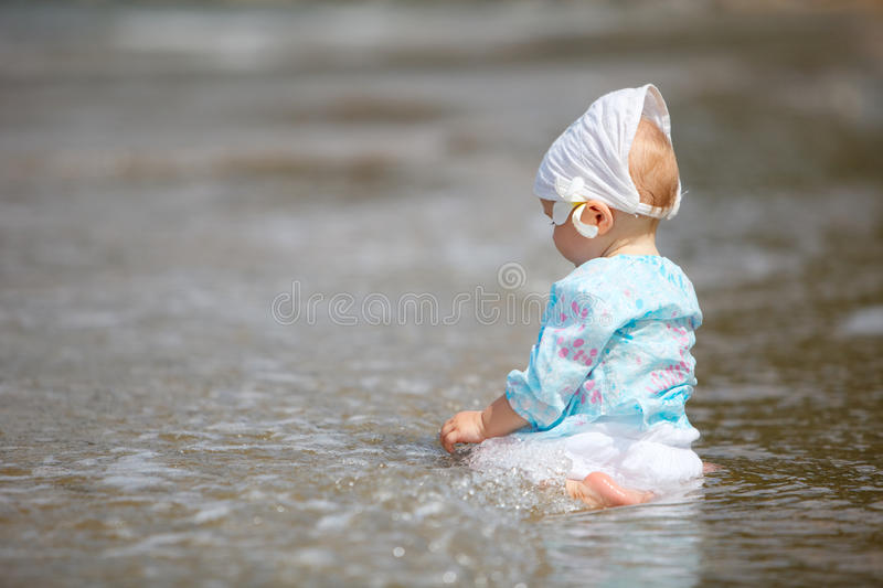 Baby at the beach stock photo