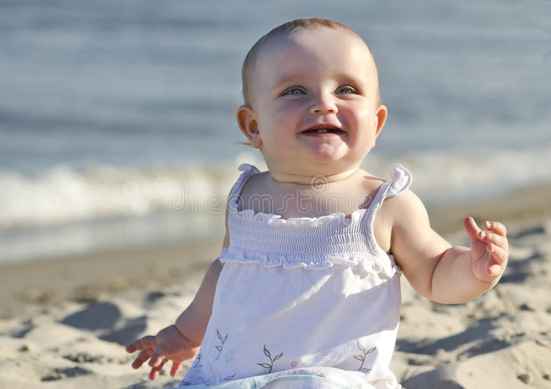 Baby on a beach royalty free stock images