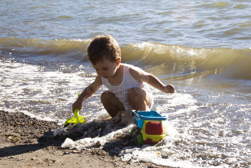 Baby on the beach royalty free stock photography