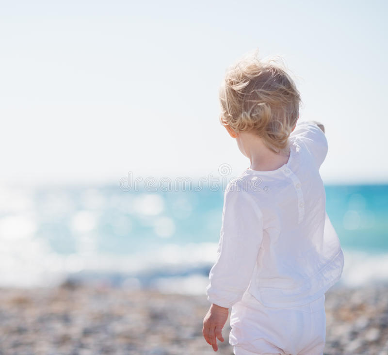 Download Baby On Beach Pointing Into Distance Stock Image - Image: 25470853