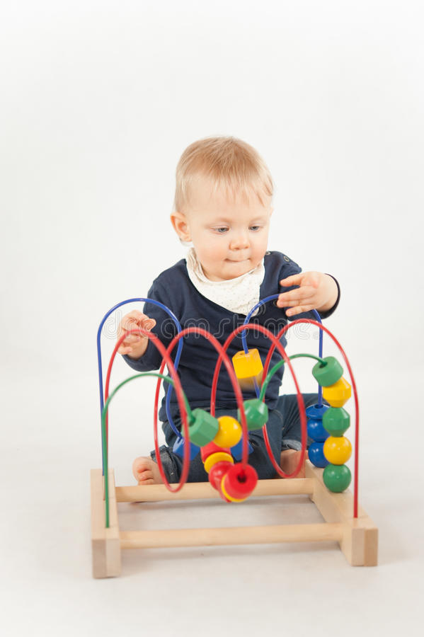 Baby With Bead Toy. On white royalty free stock images