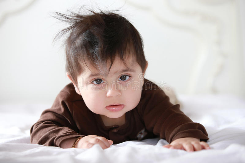 Baby in bed. Little baby in bed after waking up from his nap royalty free stock photography