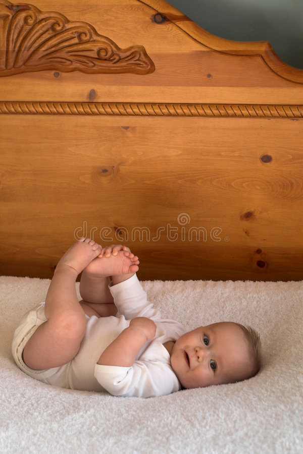 Download Baby on Bed stock photo. Image of holding, grabbing, grin - 1813700